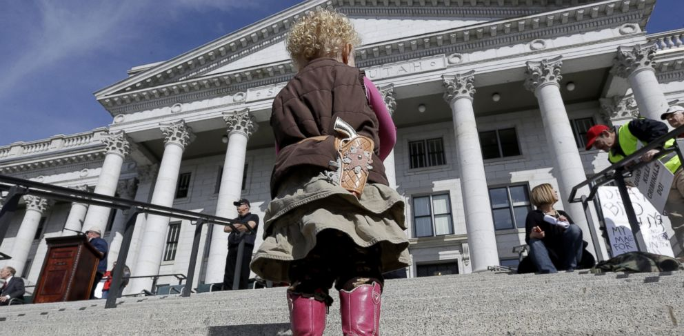PHOTO: Arinna Ludlum, 2, carries her toy six-shooter gun during a rally for the 2nd Amendment at the Utah State Capitol, March 2, 2013, in Salt Lake City.