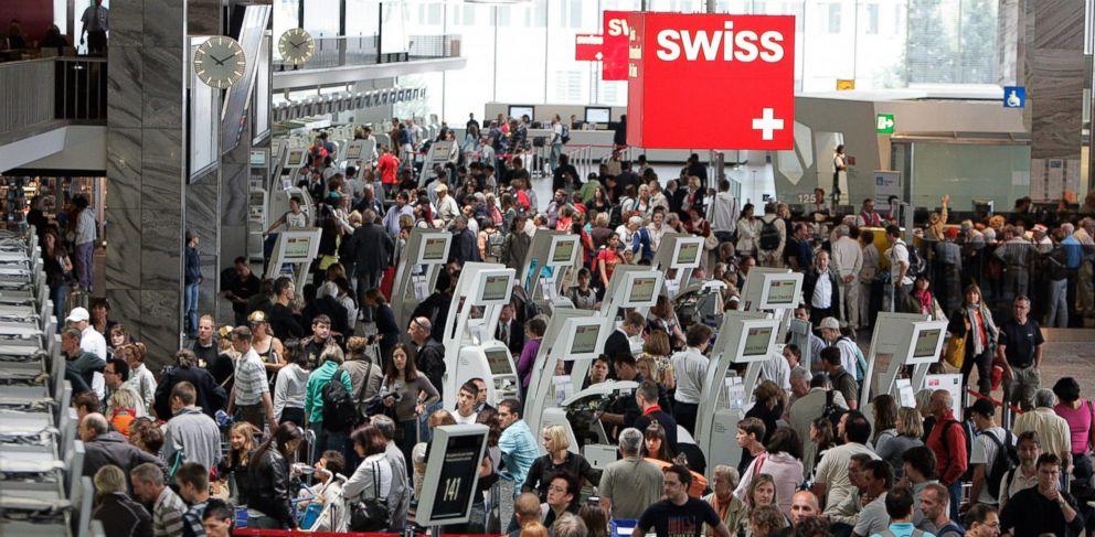 PHOTO: Passengers gather at the Zurich Airport in Kloten, Switzerland, July 11, 2009.