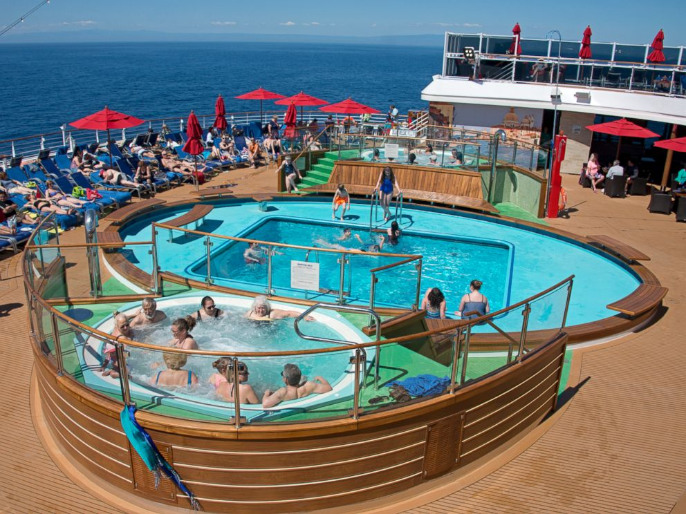 PHOTO: Guests aboard the Carnival Horizon enjoy the Tides Pool space at the aft of the 133,500-ton cruise liner.