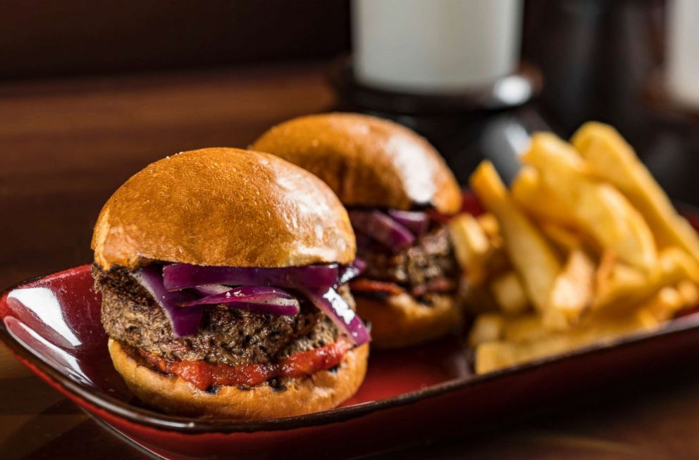 PHOTO: Plant-based burger offerings at Nomad Lounge and Restaurantosaurus. Nomad Lounge will offer Impossible Burger Sliders with tomato chutney and smoked onion on a brioche bun and served with yucca fries.