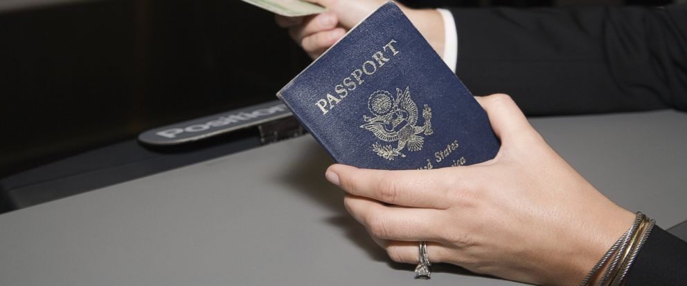 PHOTO: A woman is pictured showing a passport and airplane ticket in this stock photo.