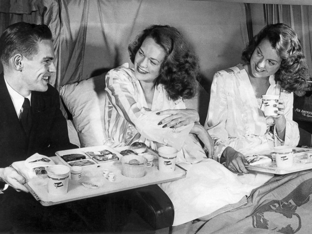 PHOTO: Twin sisters having breakfast aboard a Clipper of Pan American Airways flight during the crossing of the Atlantic, after the U.S. carrier inaugurated the line between New York and London, May 1952.