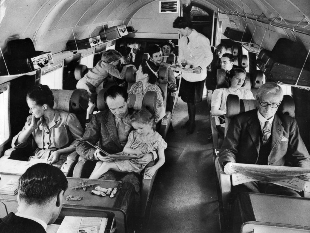 PHOTO: The interior of a BEA Vickers showing the passenger section, where the stewardess is about to serve lunch, circa 1960.