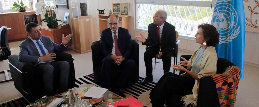 Governor of the province Nineveh Mansour al-Mareed, left, and Iraqs Culture Minister Abdulamir al-Dafar Hamdani, center, meet UNESCOS Director-General Audrey Azoulay at the UNESCOs headquarters in Paris, Wednesday, Sept. 11. 2019. Iraqi officials