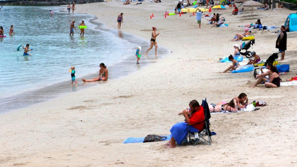 Hawaii's governor welcomes travelers as COVID counts drop