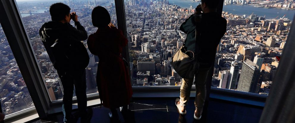 People look at the south view in the 102nd floor Observatory of the Empire State Building, in New York, Thursday, Oct. 10, 2019. (AP Photo/Richard Drew)