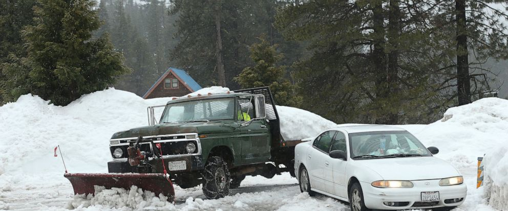 File - In this Feb. 28, 2019, file photo, snow, from recent storms, is cleared from the parking lot of the Strawberry Lodge at Strawberry, Calif. A cold front traveling down to Northern California from the Gulf of Alaska is expected to dump at least