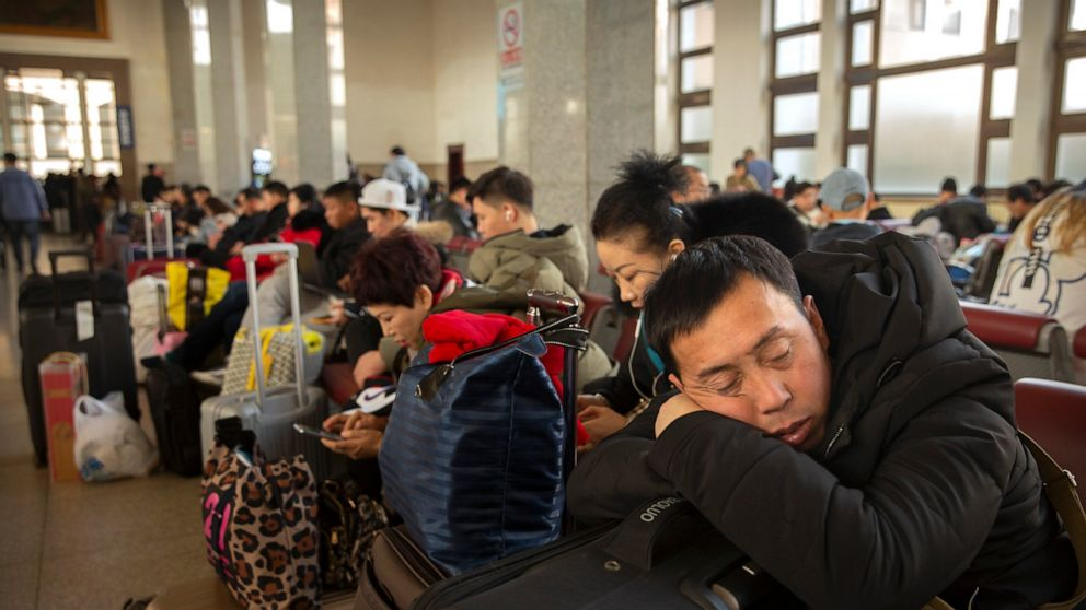 China reports new virus cases, raising concern globally before key holiday