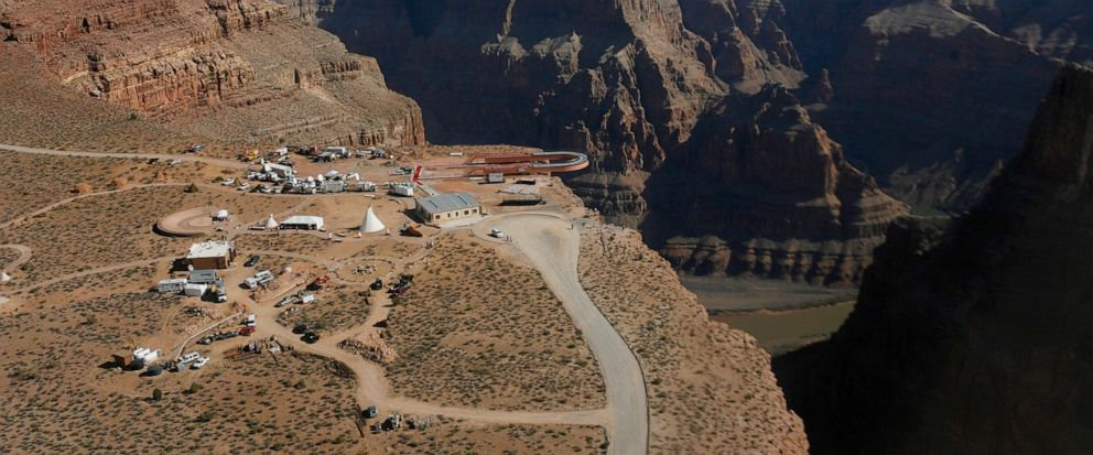 FILE - In this March 20, 2007, file photo, the Skywalk hangs over the Grand Canyon on the Hualapai Indian Reservation before its grand opening ceremony at Grand Canyon West, Ariz. Two recent deaths in which men plummeted to their death in the Grand C