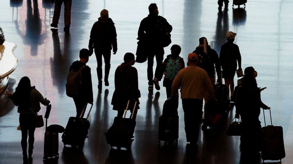 US airport traffic rising despite holiday travel warnings