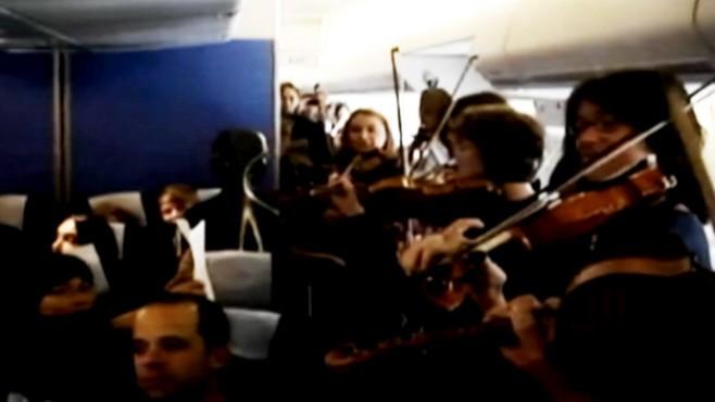 VIDEO: The string musicians of Amsterdam Sinfonietta play an impromptu Mozart concert.