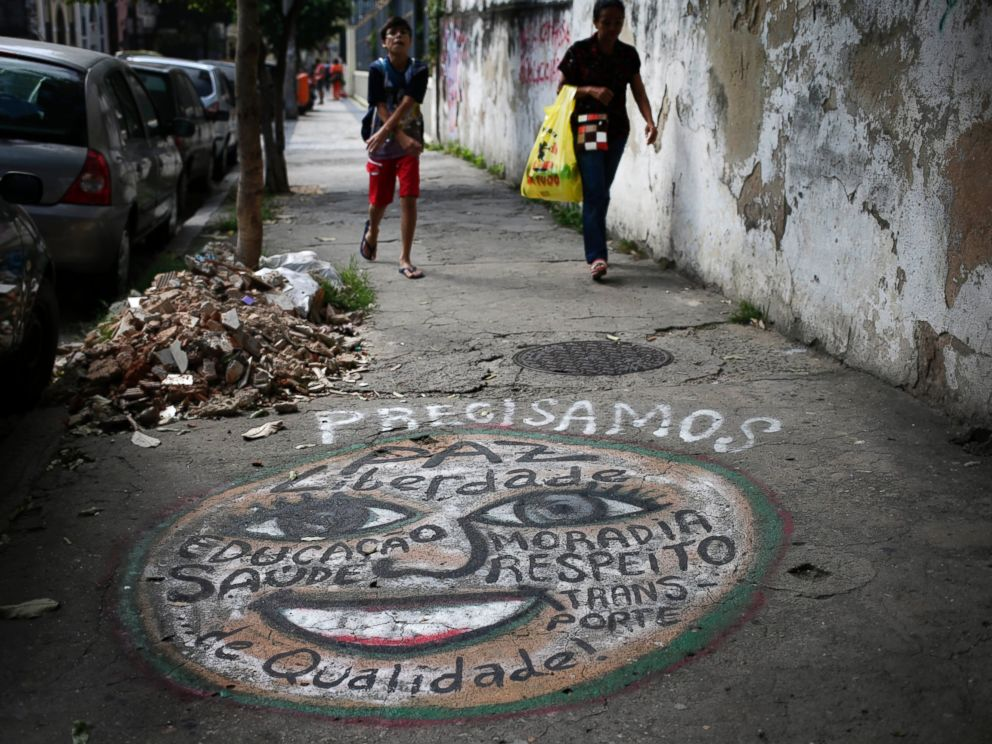PHOTO: A mural that lists many wants including better quality health care, peace, freedom, homes and transportation, adorns a sidewalk in Rio de Janeiro, Brazil, May 21, 2014.