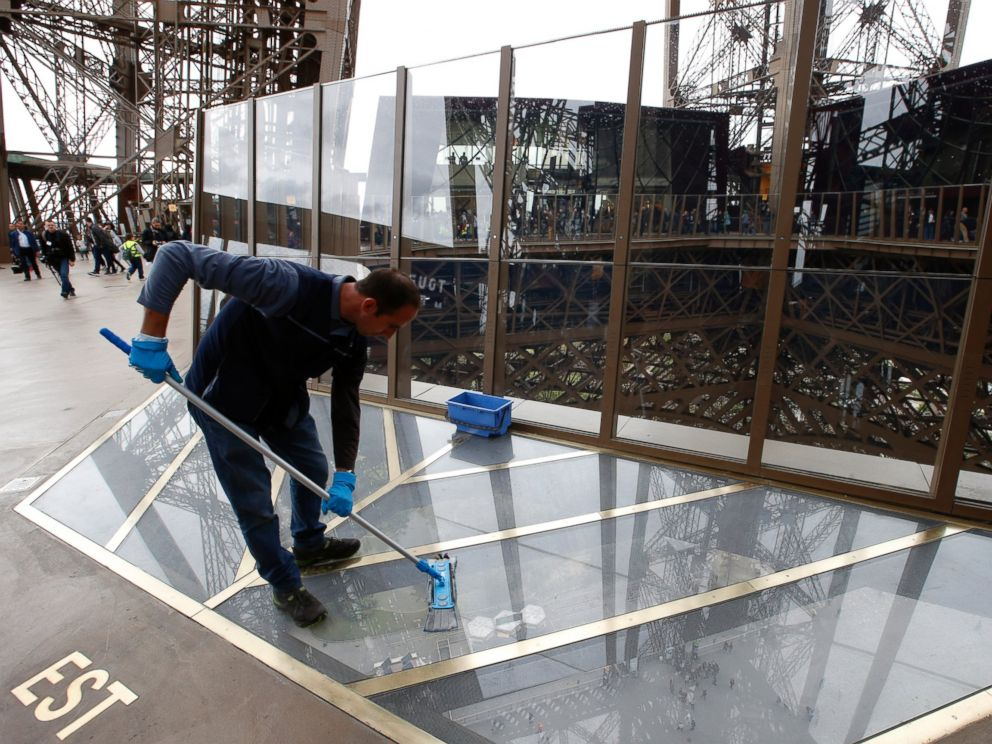 PHOTO: A worker cleans the new glass floor at The Eiffel Tower during the inauguration of the newly refurbished first floor, in Paris, Oct. 6, 2014.