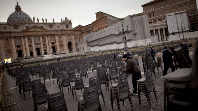PHOTO: A worker places rows of chairs in St. Peters Square ahead of Pope Benedict XVI last public audience, at the Vatican, Feb. 25, 2013. Large crowds are expected to be in the next few days.