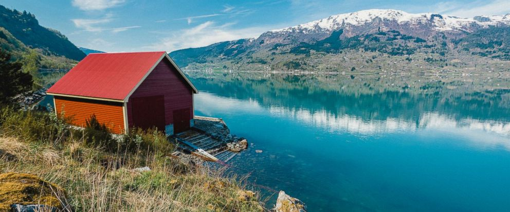PHOTO: A red house barn is pictured on the Fjord in Norway in this undated stock photo.