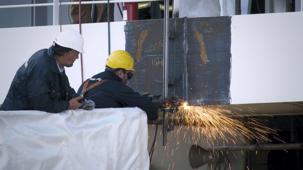 PHOTO: The Silver Spirit ship being cut in half.