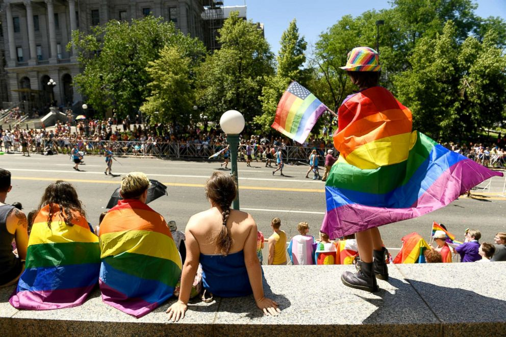 PHOTO: Spectators line the streets as they watch the 42nd annual PrideFest Parade, June 18, 2017, in Denver.