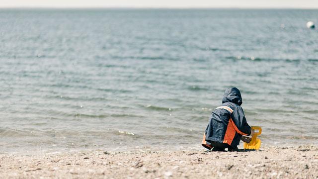 PHOTO: A boy plays on the beach in Rowayton Conn.