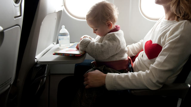 PHOTO: Babies under the age of two who are allowed to fly for free if seated on a parents lap.