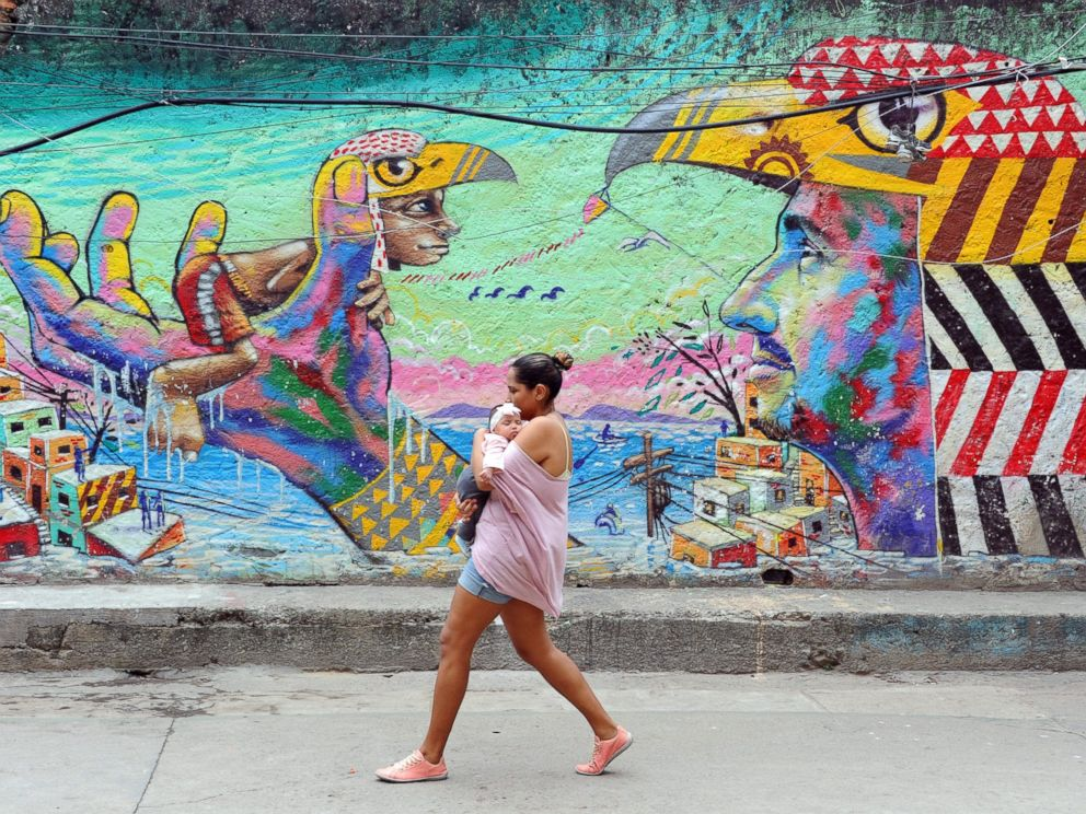 PHOTO: A woman and her baby walk in the streets of the Cantagalo favela, next to Copacabana on April 23, 2014, in Rio de Janeiro.