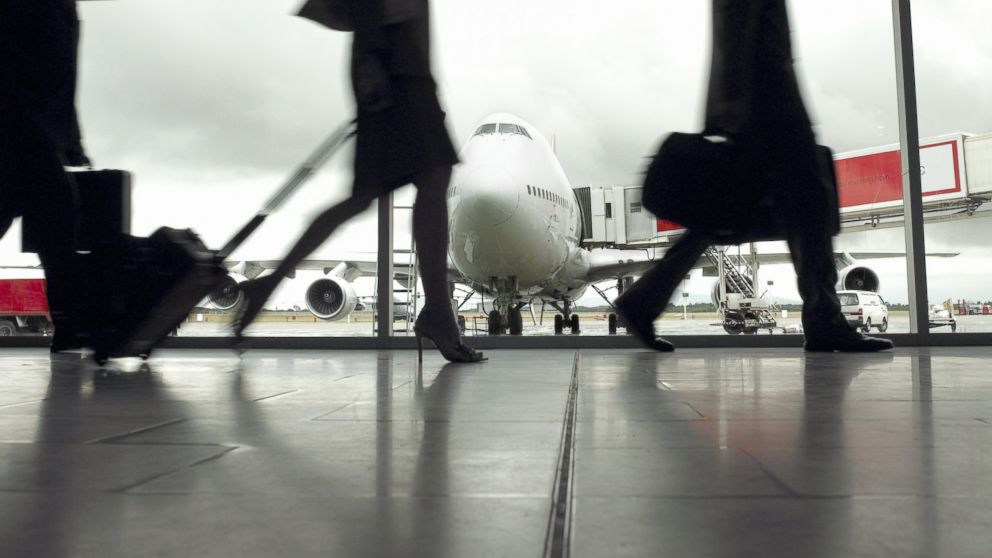 Travelers are pictured in an airport in this undated stock image.