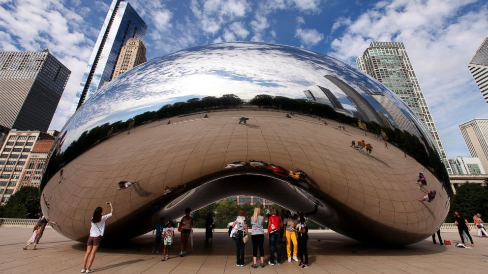 "Anish Kapoor's Cloud Gate sculpture, also known as ""The Bean,"" is a must-see attraction in Millennium Park in Chicago."