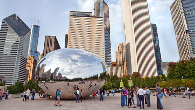 PHOTO: Tourists admire The Cloud Gate, also called the Bean, sculpture in Millennium Park in Chicago.