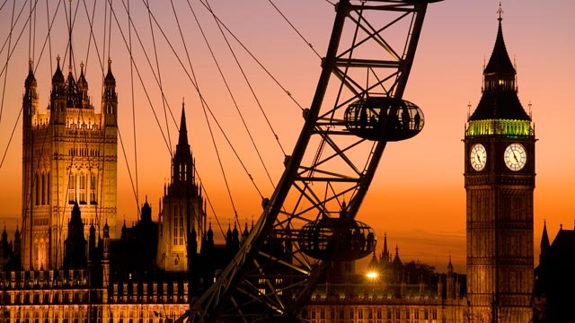 PHOTO: Big Ben, The London Eye and Parliment are seen at dusk in London, England.