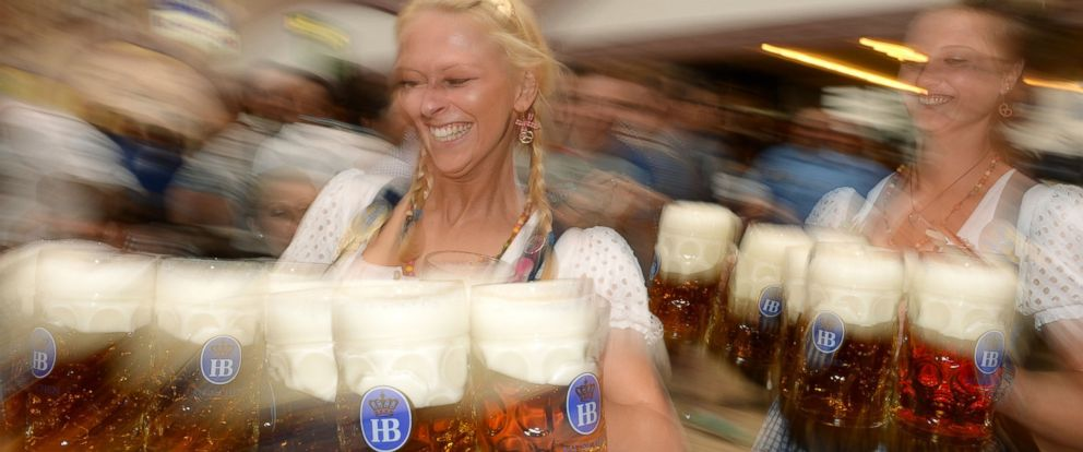 PHOTO: Waitresses serve beer during the opening of the Oktoberfest beer festival in Munich, Germany on Sept. 21, 2013.
