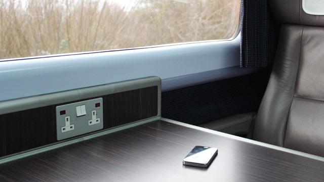 PHOTO: Smart phone on train table.