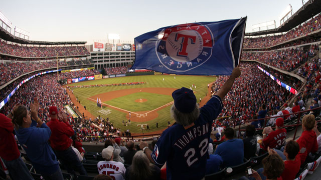 PHOTO: A fan waves a flag during Game Four of the MLB World Series between the St. Louis Cardinals and the Texas Rangers at Rangers Ballpark in Arlington on Oct. 23, 2011 in Arlington, Texas.
