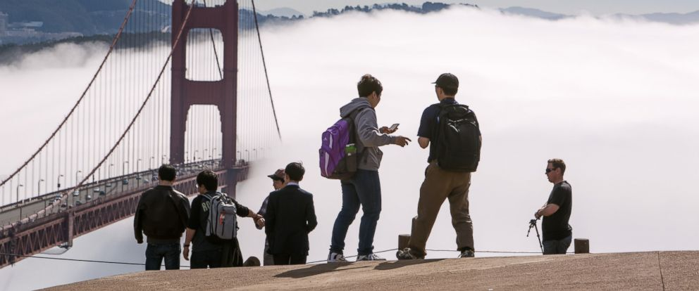 PHOTO: A group of tourists take photographs at the Golden Gate Bridge on Feb. 13, 2014, in San Francisco, Calif.