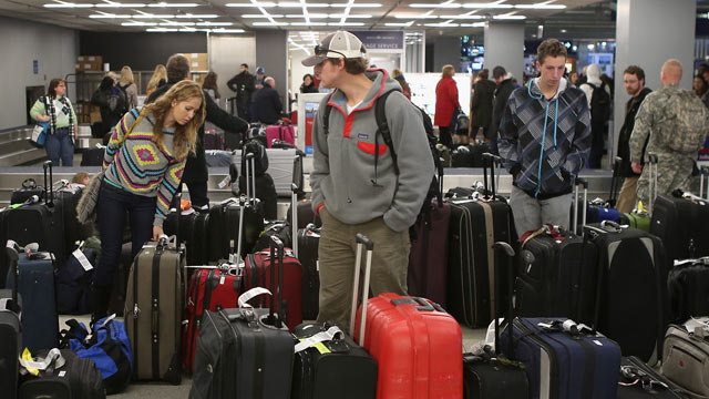 PHOTO: Holiday travelers are seen with their luggage, Dec. 21, 2012.