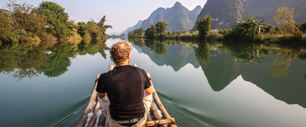 PHOTO: A man travels on a bamboo boat in China in an undated stock photo.