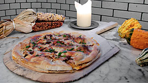 Photo: Manhattan?s La Bottega Italian restaurant has found the perfect use for Thanksgiving feast leftovers: a pizza stuffed more heavily than the holidays turkey