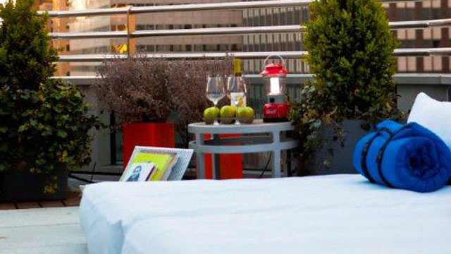 """PHOTO: Beds, snacks and wine service are set up on room terraces as part of Hyatt 48 Lex's """"Suite Glamping"""" program."""