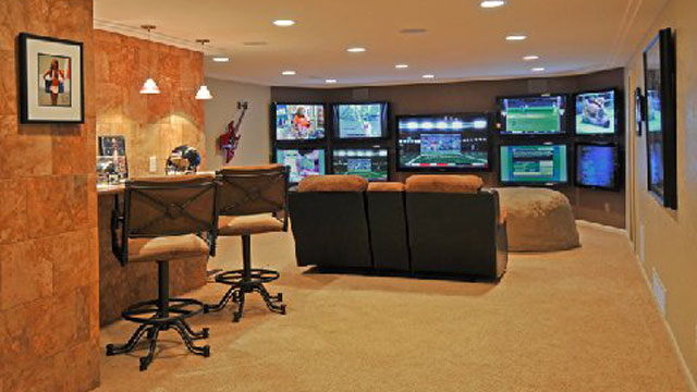 PHOTO: Bob Footitt's Man Cave, aka Plasma Cave. He sold blood to help pay for all the big screens in the room.