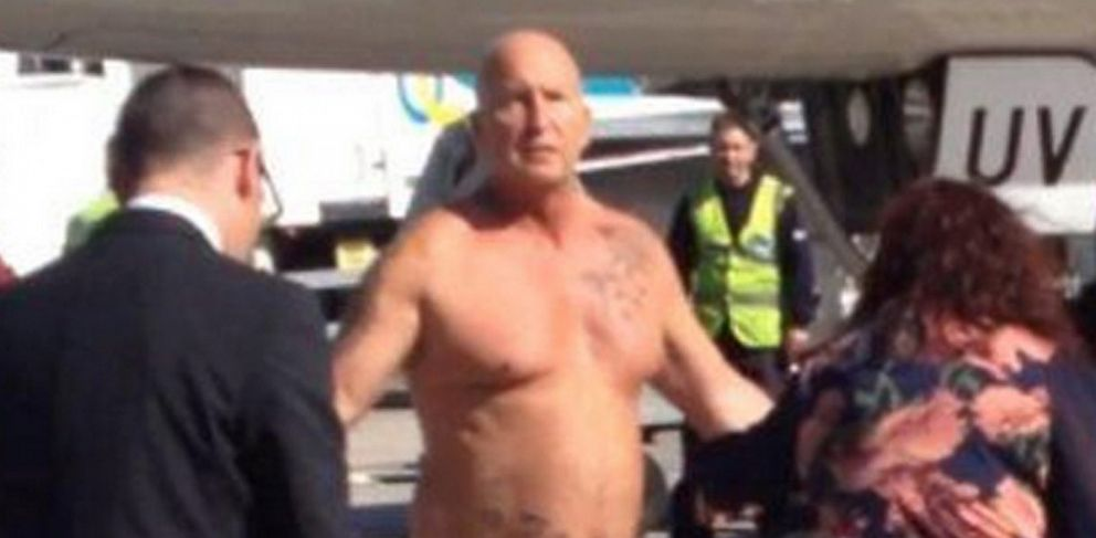 PHOTO: A drunken jet passenger, who had arrived in Manchester on an easyJet flight from Malta, was tasered by police after stripping naked on the airport tarmac and challenging the captain to a fight.