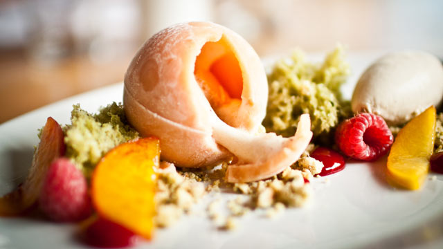 PHOTO: The frosty peach sphere that dominates this dessert is actually sorbet, with a relatively healthy peach and fresh raspberry filling.