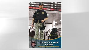 Photo: Amtrak Police Sgt. Robert A. Smith and his black Labrador retriever Zorro