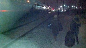 PHOTO: Train passengers disembark train after hours stranded on tracks outside Perryville, Md.
