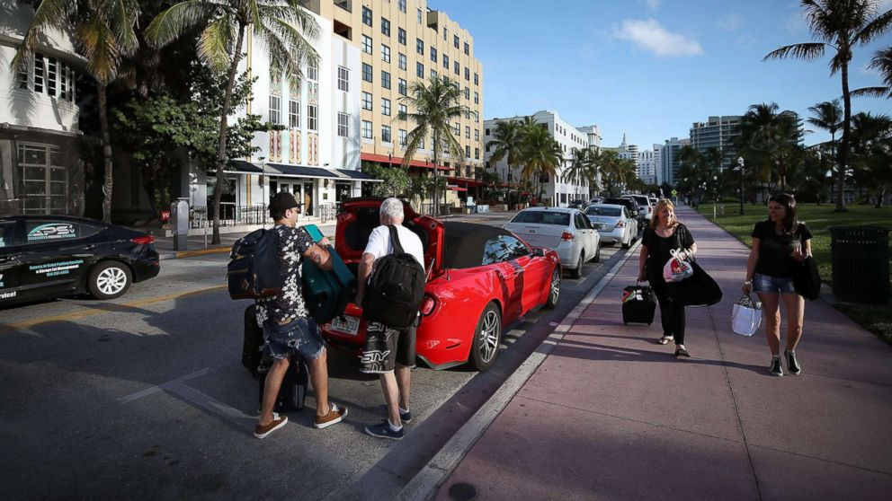 People pack up their car to evacuate as the city prepares for Hurricane Irma, Sept. 7, 2017 in Miami Beach, Florida.