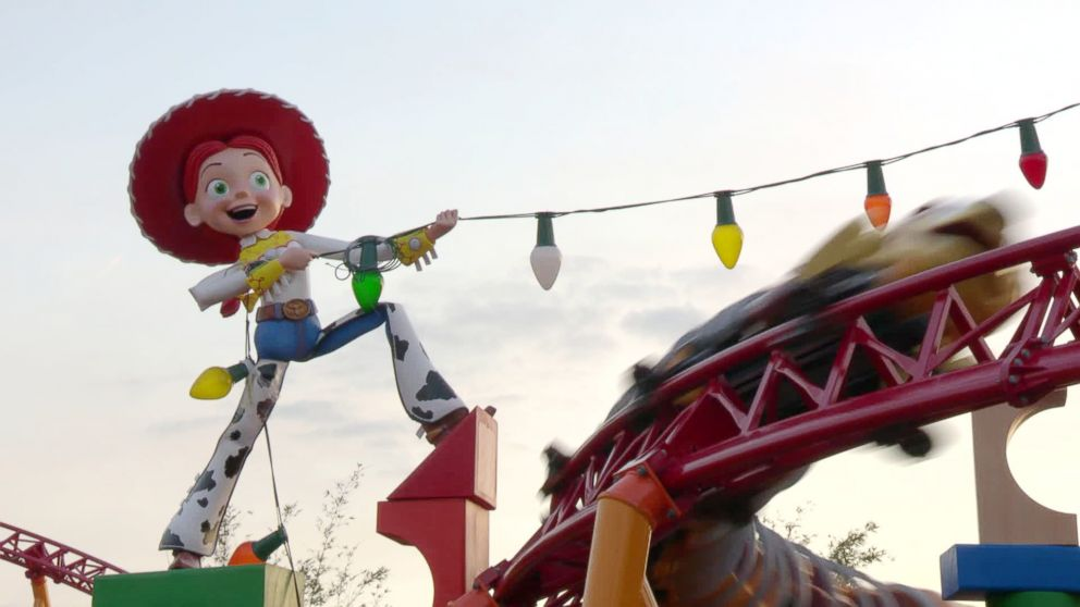 PHOTO: Slinky Dog Dash dashes is seen by a giant Jesse doll.