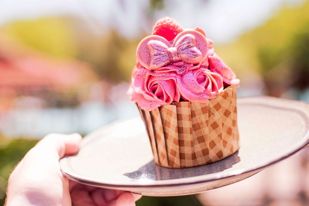 PHOTO: This chocolate devil's food cupcake is filled with raspberry mousse and topped with millennial pink buttercream, fondant ears, and edible glitter.