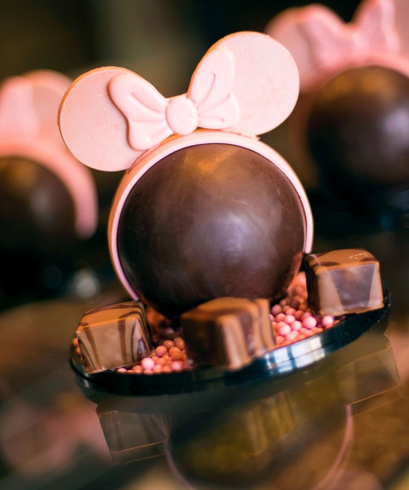 PHOTO: A dark chocolate dome filled with vanilla bean marshmallows and strawberry crispy pearls and topped with edible white chocolate ears.