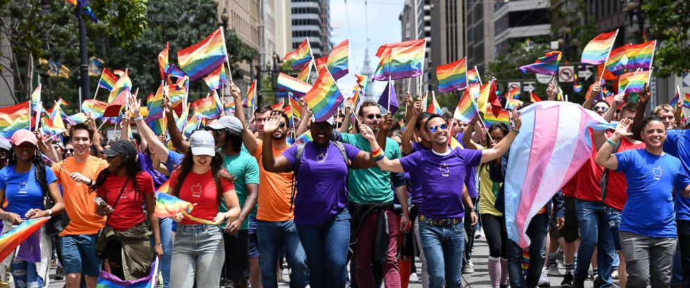 PHOTO: People march with Gay Pride colors during San Francisco Gay Pride parade, June 25, 2017, in San Francisco.