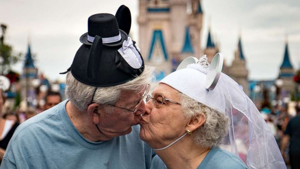 The Crisps share a kiss while vacationing in Disney World in 2016 with other nursing home residents from Riverview Health Care Center in Prestonsburg, Ky.