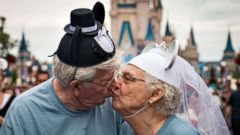 PHOTO: The Crisps share a kiss while vacationing in Disney World in 2016 with other nursing home residents from Riverview Health Care Center in Prestonsburg, Ky.