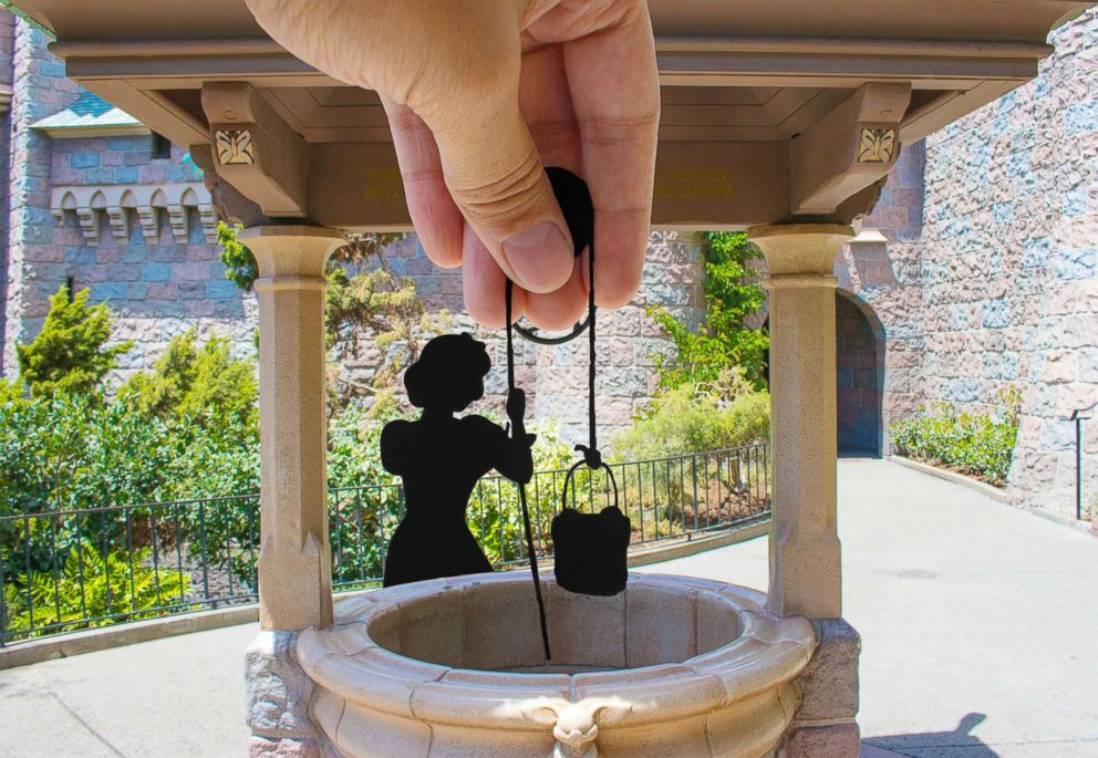 PHOTO: Paper at is pictured over Snow Whites Wishing Well in Disneyland.