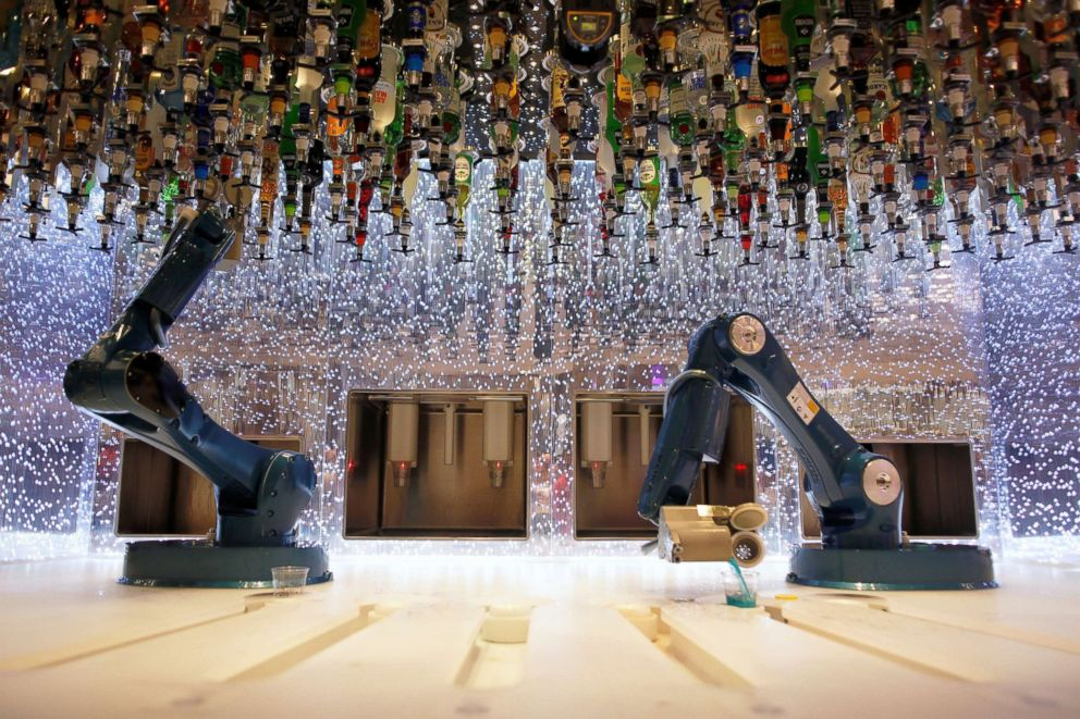 Robots serve drinks at the bionic bar on the world's largest cruise ship of Royal Caribbean Cruises during its world presentation ceremony at a port in Malaga, Spain, March 27, 2018.
